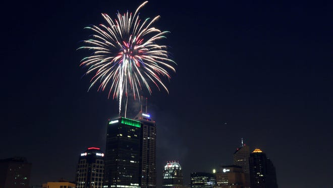 Fireworks explode over downtown Indianapolis as seen from the rooftop of the Old National Centre, Saturday, July 4, 2015, Indendence Day, Indianapolis, Ind.
