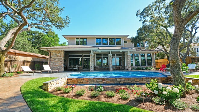 Grass Roots Lawn Care worked to create a stunning landscape for entertaining.