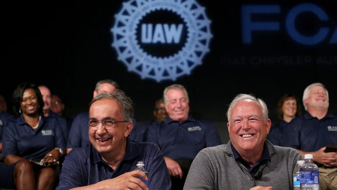 Fiat Chrysler CEO Sergio Marchionne, left, speaks to the media with UAW President Dennis Williams, during an event to mark the ceremonial beginning of its contract talks at the UAW-Chrysler National Training Center in Detroit on Tuesday, July 14, 2015.