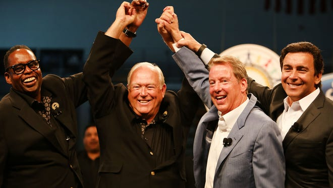 Ford and UAW marks the official start of contract talks with a group handshake with UAW Vice President Jimmy Settles, left, UAW President Dennis Williams, Executive Chairman of Ford Bill Ford Jr. and Ford CEO Mark Fields today at Cass Technical High School Thursday, July 23, 2015.