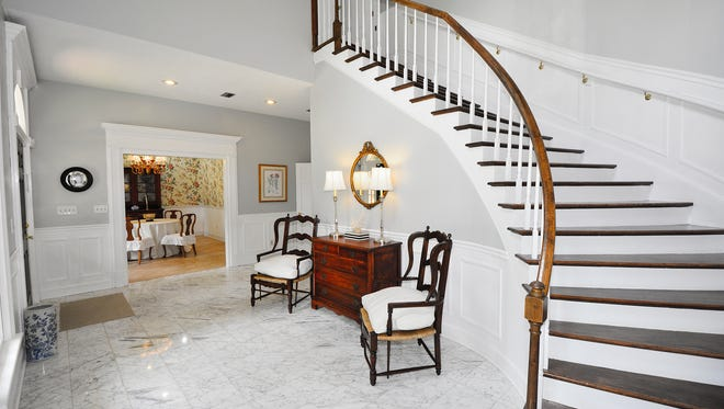 5670 Wychewood Road, the entry foyer with a fabulous curved staircase.