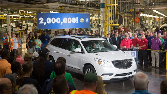 General Motors North America Manufacturing Manager Scott Whybrew addresses the gathering as the 2 millionth vehicle, a 2016 Buick Enclave, rolls off the production line at the General Motors Lansing Delta Township Assembly Plant Friday, August 14, 2015, in Lansing, Michigan. Manufacturing was one of the sectors in Michigan's economy that added jobs in July 2015.