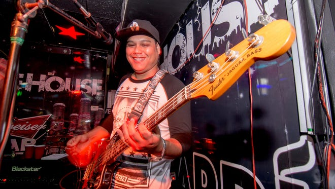 Flinched's Jason Mendiola on bass performing with the band at Livehouse on Aug. 14.
