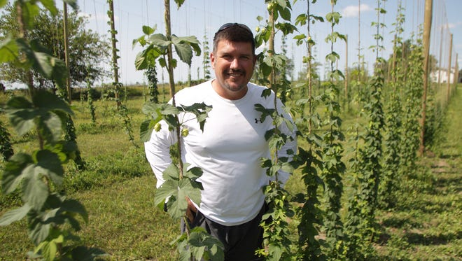 Mark Pattison poses for a photo at Buck Creek Hops Farm north of Iowa City on Wednesday, Aug. 26, 2015.