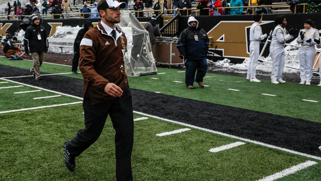 Western Michigan's head coach P.J. Fleck leaves the field after his team was defeated by Northern Illinois, Friday, Nov. 28, 2014, at Waldo Stadium, in Kalamazoo, Mich. (AP Photo/Kalamazoo Gazette-MLive Media Group, Junfu Han )