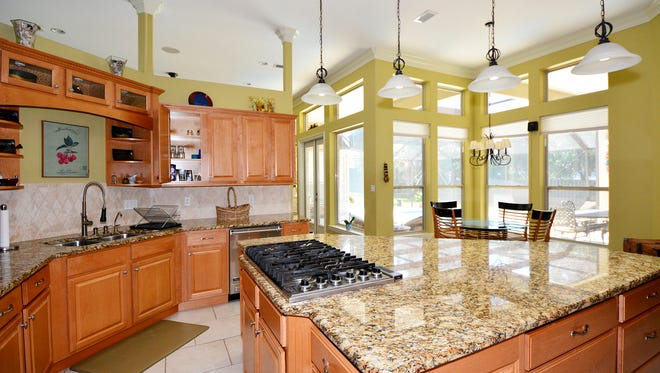2533 Shadowridge Court, the kitchen features a large island.