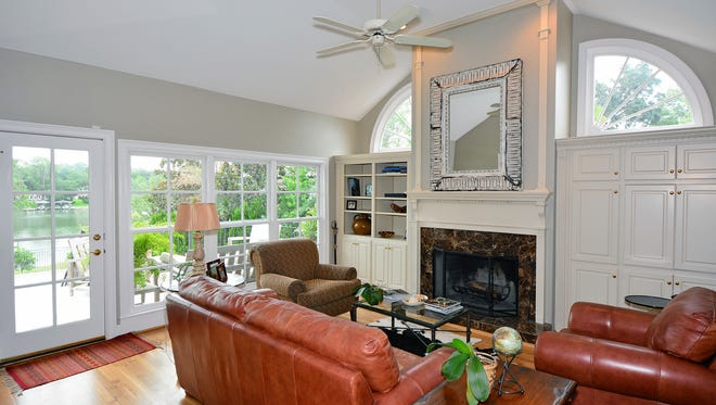 3020 Blackshear Avenue, the family room with a fireplace and access to the balcony.
