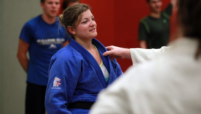 Melissa Myers leads a University of Iowa Judo Club practice at the Field House on Thursday, Sept. 3, 2015.