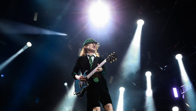 Lead guitarist Angus Young performs with AC/DC during the AC/DC: Rock or Bust World Tour on Tuesday September 8, 2015 at Ford Field in Detroit.