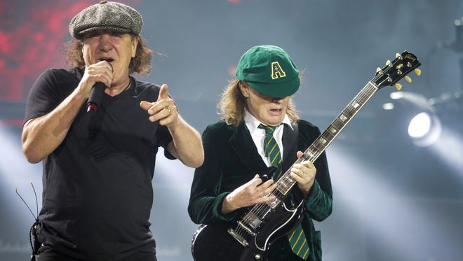 Brian Johnson and Angus Young perform with AC/DC during the AC/DC: Rock or Bust World Tour on Tuesday, Sept. 8, 2015, at Ford Field in Detroit.