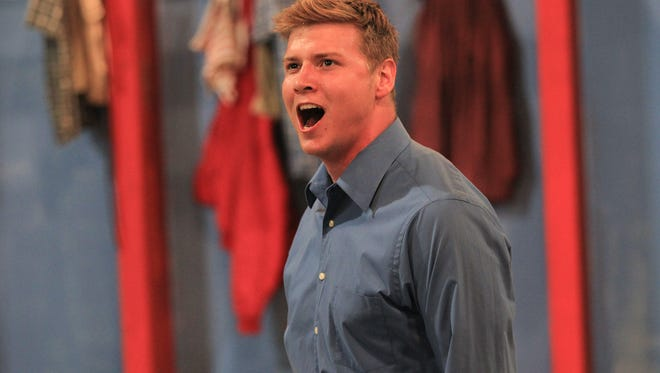 "Jaecob Lynn, who plays the role of Joe Hardy, rehearses a scene from ""Damn Yankees"" at the Johnson County Fairgrounds on Thursday, Sept. 10, 2015."