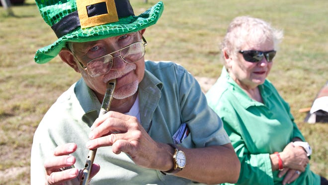 Bob and Mimi Harty Koerner of Brick with Irish whistles.  The 17th annual Irish Festival takes place at the National Guard Armory.