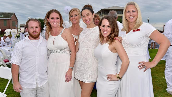Andrew Hudson, Ashley Burkett, Kathi Cotti, Jennifer De Loach, Laken Hudson and Heather Russell at the Evening in White supporting the Junior League of Pensacola.
