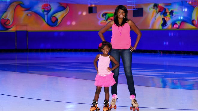 Kay Mitchell skates for a cure. Kay Mitchell with her daughter.
