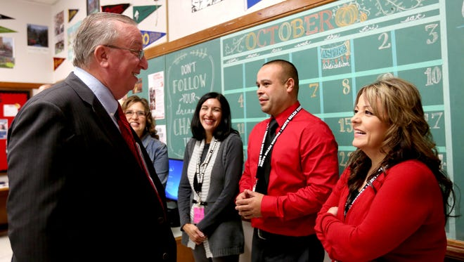 Greg Darnieder, left, with the U.S. Department of Education, speaks with ASPIRE Coordinators during the dedication ceremony for an ASPIRE Center at North Salem High School in Salem on Thursday, Oct. 1, 2015. The Salem-Keizer School District is now the first district in Oregon to have the college and career mentoring program in all middle and high schools.