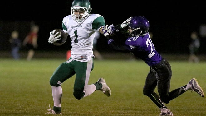 Salem Academy's Skyler Williams (1) blocks Jefferson High School defender Jacob Sobel (20) during their game on Friday, Oct. 9, 2015, in Jefferson, Ore.