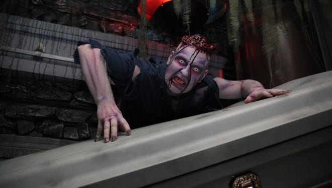Ghouls pop out of expected and unexpected places at Erebus 4 Story Haunted Attraction in Pontiac.