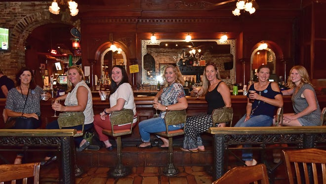 A stop at Seville Quarter. From left to right: Tracy Steiner, Meredith McDuffie, Mickaela Lusignan, Cindy Mikuszewski, Nichole Morkes, Michelle Brunke and Kate Gaskin.