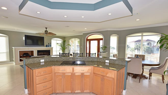 504 Eventide Drive, open kitchen with bar seating.