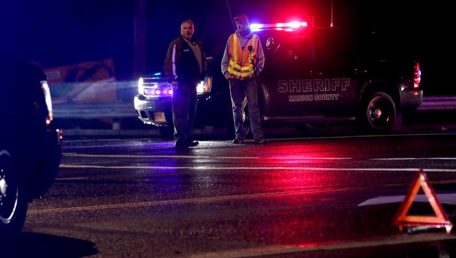 Emergency personnel direct traffic following an officer-involved shooting at Kuebler Blvd. and I-5 in Salem on Wednesday, Oct. 28, 2015.