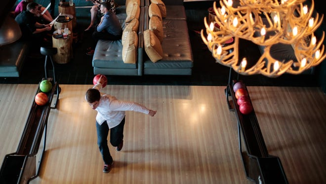 Chris Crane of Rochester makes his approach on the lanes at Punch Bowl Social in Detroit. Not the mountain lodge feel of the antler chandelier. The location opened in August 2015. It also houses ping-pong tables, arcade games and shuffleboard.