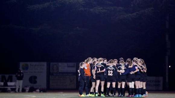 Silverton players gather on the field after the Silverton vs. Corvallis girl's soccer Mid-Willamette Conference championship game at Corvallis High School on Tuesday, Oct. 27, 2015. Corvallis won the championship 2-1.