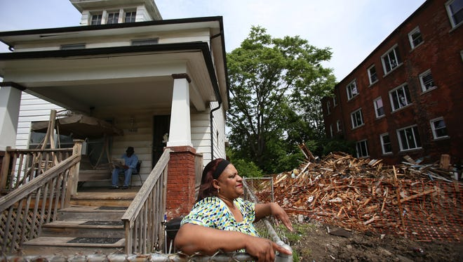 Yetivia Sumling-Adams, 58, and her husband Robert Adams, 64, have lived in their home on Lee Place in Detroit for 23 years. On May 24, the house on the right was demolished, but the debris was never picked up even after they came back to demolish the house on the left two days ago.