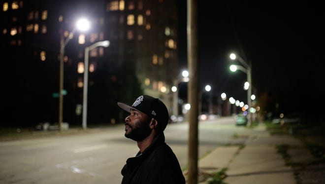 Detroit resident Jerald Gossett, 33, talks about how the added LED streetlights have made his commute safer at night along Second Avenue near the New Center area of Detroit  on Wednesday, Nov. 4, 2015.