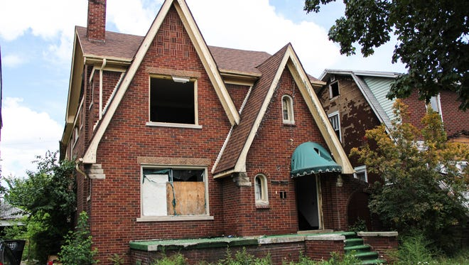 The house at 7124 Tuxedo, in Detroit, in the late summer of 2012. Free Press Editorial Page Editor Stephen Henderson's family lived in the second-floor apartment of the house when he was born in 1970. The house went abandoned, and was stripped, in early 2012. Henderson hopes to remake the house as a writers residence and literary center for the neighborhood.