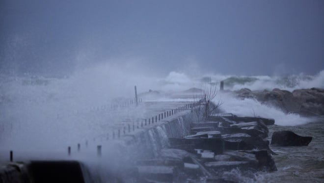 Waves batter the southern Muskegon breakwater in Muskegon today.