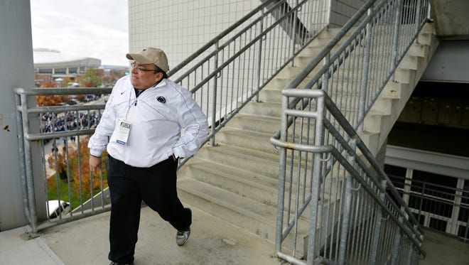 "Brad ""Spider"" Caldwell takes the stairs down from the Mount Nittany Club level at Beaver Stadium before Penn State's noon game against Illinois. Caldwell began his 31-year tenure with the Penn State football equipment staff as a student manager in 1983."