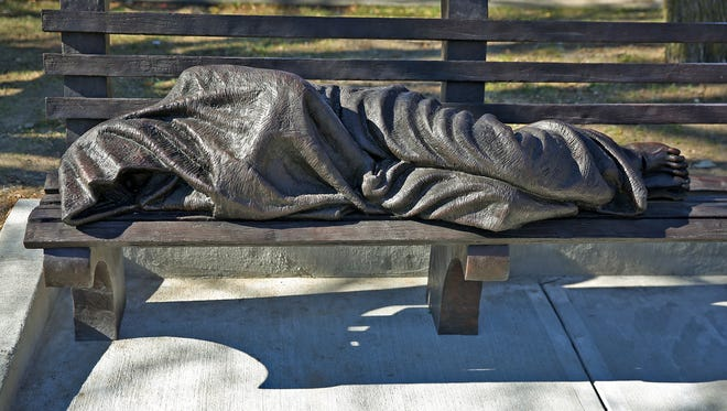 A blanketed figure on a park bench, the Homeless Jesus statue, was unveiled Nov. 13, 2015, at Roberts Park United Methodist Church. The statue, which is a permanent reminder of homelessness in Indianapolis, was created by Canadian artist Timothy P. Schmalz. It is at the intersection of Alabama Street, Vermont Street and Massachusetts Avenue.