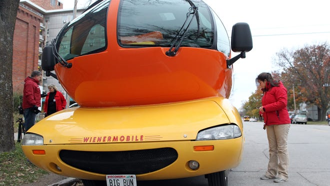 Molly Ward, of Johnston, gets the Wienermobile ready for a day in Iowa City.