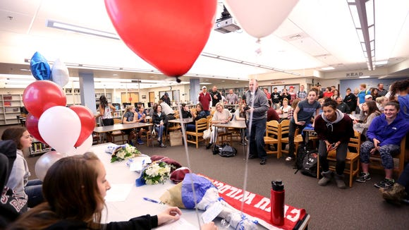 Family and friends gather for a signing day ceremony at McNary High School in Keizer on Tuesday, Nov. 17, 2015.