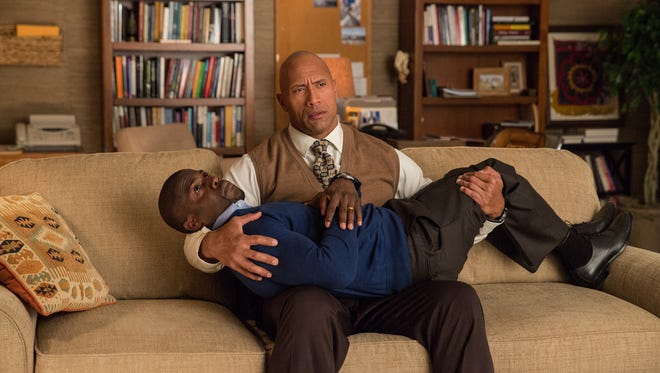 Kevin Hart is an easy armful for Dwayne Johnson in 'Central Intelligence.'