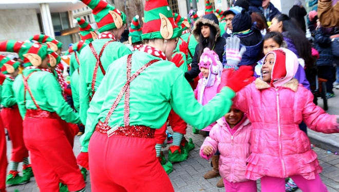 Clad in red and green, Santa's helpers will be everywhere at Detroit's Thanksgiving parade.