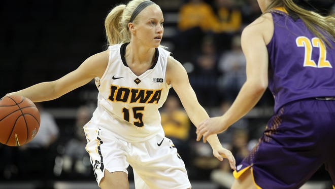 Iowa's Whitney Jennings looks for an open teammate during the Hawkeyes' game against Western Illinois at Carver-Hawkeye Arena on Thursday, Nov. 19, 2015.