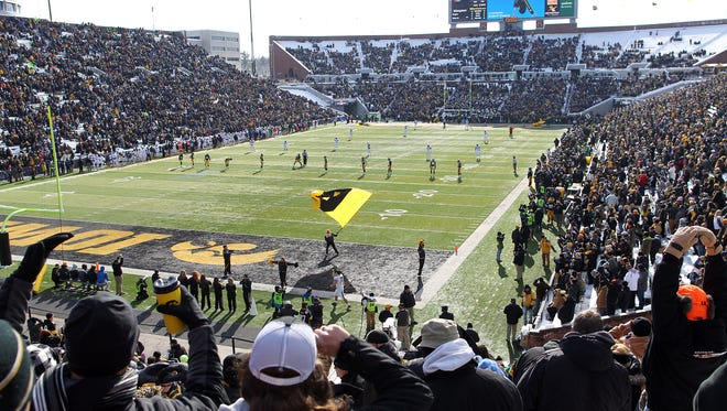 Iowa fans cheer on the Hawkeyes during their game against Purdue at Kinnick Stadium on Saturday, Nov. 21, 2015.