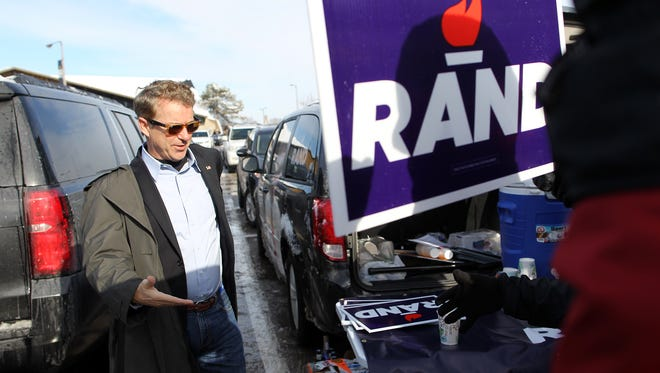 Republican presidential candidate Rand Paul greets supporters prior to the Hawkeyes' game against Purdue at Kinnick Stadium on Saturday, Nov. 21, 2015.