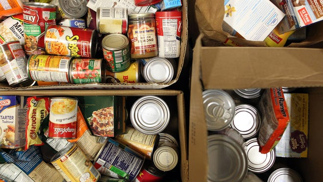 Non-perishable food piles up in the back room of the North Liberty Community Pantry on Tuesday, Nov. 24, 2015.
