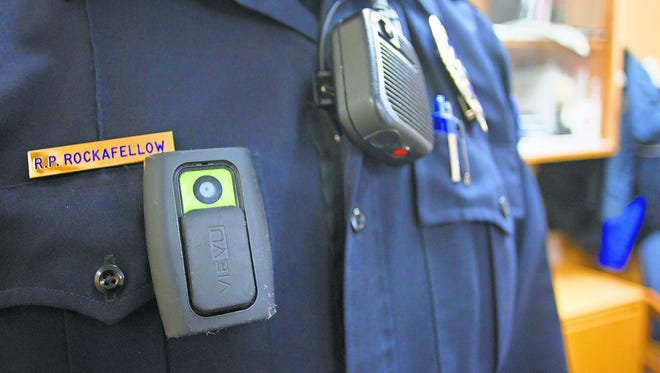 North Liberty police officer Ryan Rockafellow displays his body camera at the North Liberty police station on Friday, Jan. 30, 2015.