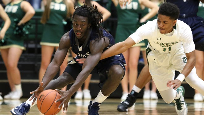 CSU's Prentiss Nixon reaches in to try to steal the ball from Arkansas-Fort Smith's Richie Spiller during Wednesday night's game at Moby Arena. The Rams beat the Lions to snap a three-game losing streak.