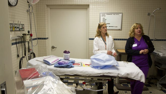 CentraState Medical Center nurses Karyn Young-Engelman (left) and Lori Impastato work at the Freehold Township hospital in this 2014 file photo.