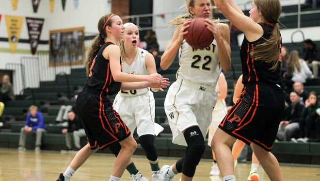 West High's Logan Cook drives to the hoop during the Women of Troy's game against Cedar Rapids Prairie on Tuesday, Dec. 1, 2015.