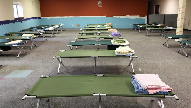 Cots are seen in a temporary winter homeless shelter in this file photo from Monday, Dec. 14, 2015.