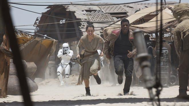 'Star Wars: The Force Awakens': L to R: Rey (Daisy Ridley) and Finn (John Boyega)
