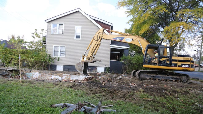 Houses on the 1500 block of Alter are taken down.