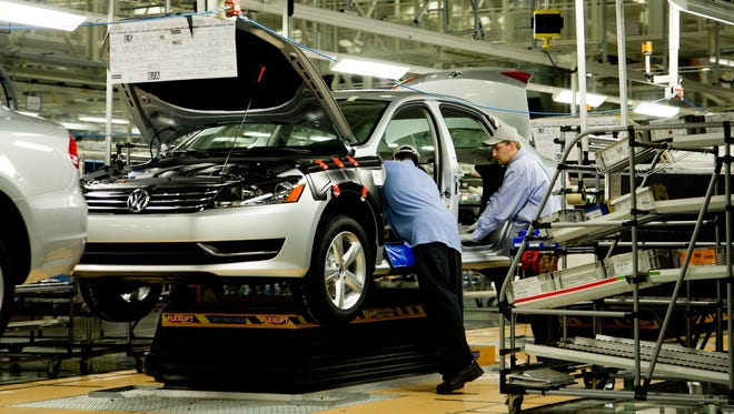 Workers assemble a Volkswagen Passat at the German automaker's Chattanooga, Tenn., plant on Thursday, March 22, 2012.