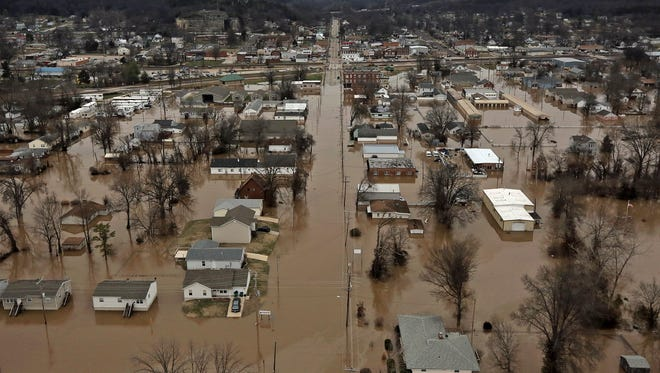 This photo shows a northern view of 1st Street where homes were flooded on Tuesday, Dec. 29, 2015, in Pacific, Mo. Torrential rains over the past several days pushed already swollen rivers and streams to virtually unheard-of heights in parts of Missouri and Illinois.