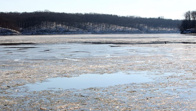 Chunks of ice float through the Coralville Lake near a boat launch location at Lake Macbride State Park on Monday, Jan. 4, 2016. Multiple agencies were used to search the Coralville Lake for a person after a canoe capsized Sunday afternoon.
